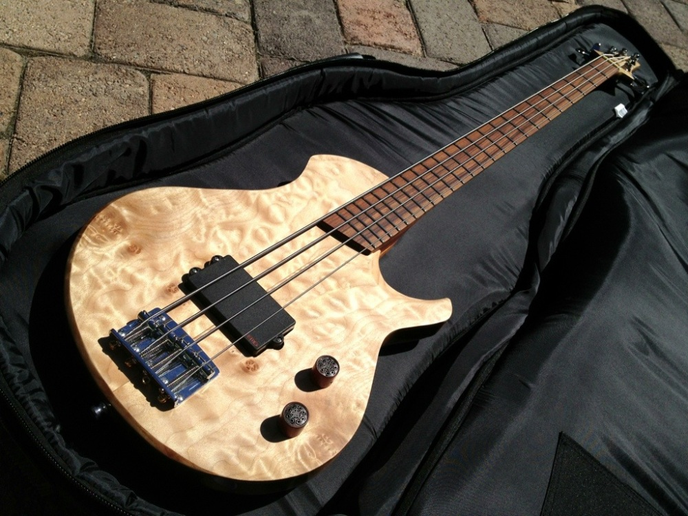 "This is a 34""in scale 4 string bass guitar. Quilted Maple Top with african mahogany back. Bubinga neck with burl maple stripe and pau ferro fretboard. EMG MMTWX single active pickup. Hipshot bridge and Gotoh tuners. Finished with Tru oil and wax"
