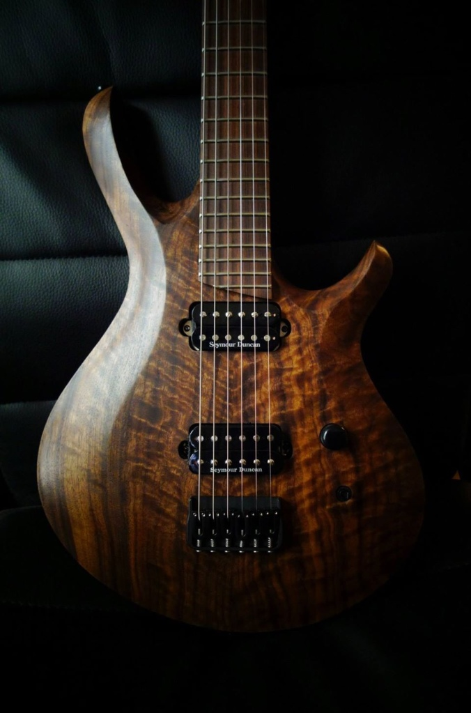 This is a Figured English Walnut Carved Top with Sapele body made for Ryan O John. Neck is Monterillo with a pau ferro FB. Stew mac Frets and Seymour duncan Custom 5 bridge and Jazz Neck Pickups. Hardware is all Hipshot. 26